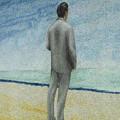 海を眺めている男