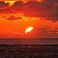 Photos: 日本海と雲に沈む夕陽